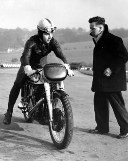 John Surtees practising at Brands Hatch on his Norton motorbike. He is trying to