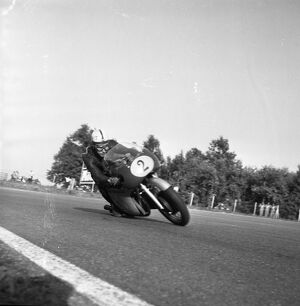 John Surtees rounds a corner at the Italian Grand Prix Surtees won both the 350cc