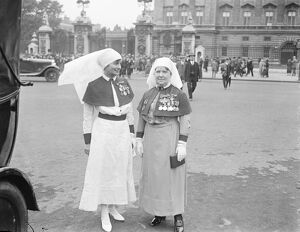 King holds investiture at Buckingham Palace. Matron in Chief Florence Hodgins