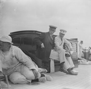 "The King takes the wheel of his yacht "" Britannia "". The Duke of Connaught and Sir"