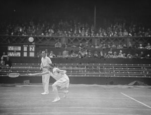 Lawn tennis at Wimbledon. Mr and Mrs L A Godfree in play. 5 July 1927