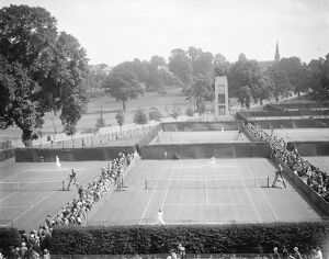 Lawn tennis at Wimbledon. A panoramic view showing play in progress on the courts