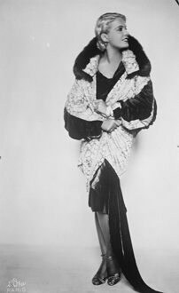 Lili Damita, wearing the magnificent silver brocade coat presented by Jenny. 24