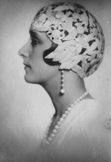 Forty little birds sacrificed to make a beauty ' s cap. Countess de Wengen, wearing