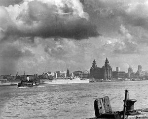 The Liverpool skyline as viewed from Seacombe, Cheshire ; Royal Liver Building