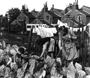 London. Bermondsey brightens up her bomb sites. 1950. Alma Grove, Bermondsey. Women
