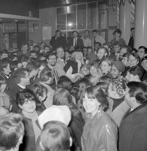 London : Fans surround folk singers Peter ( with glasses ), Paul and Mary as they