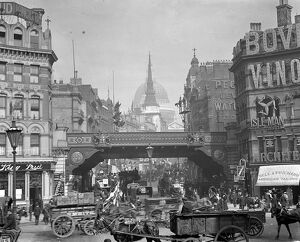 London street scene. Busy horse - drawn traffic at Ludgate Hill, looking towards St