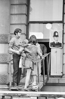 London: A women and child is assisted by squatters to enter the empty 60 room mansion