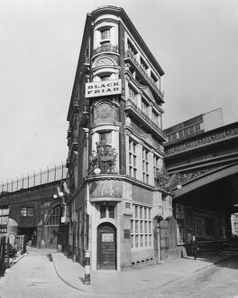 London's flat-iron building - The Black Friar pub at the junction of Queen Victoria