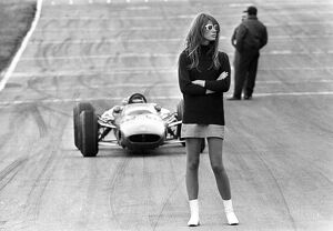 Look out, beautiful. Brands Hatch, England ; Nonchalent hazard for racing drivers
