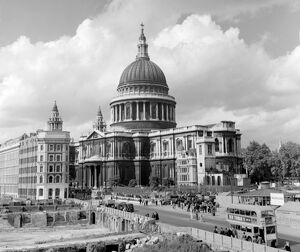 Looking at St Paul's Cathedral, down Cannon Street, with a derelict bomb - site nearby