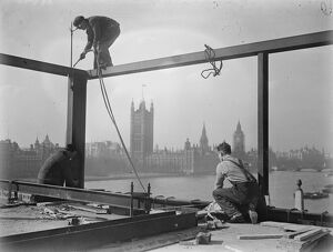 He looks down on Parliament. A welder on a precarious perch high above the Albert