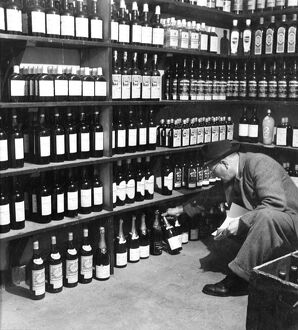 Man looking through the wines and spirits in the off licence department of the Globe