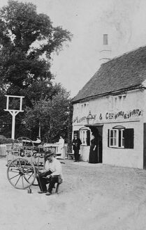 A man with a small cart outside public house at Eversley 1906