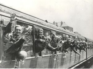 Men of the British Expeditionary Force returning from the Flanders evacuation, give