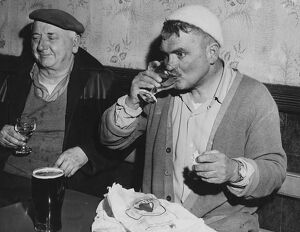 Men of Harlech taste the wine and wash away the taste with a pint of beer. Gwynedd