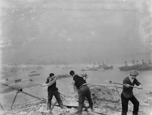 Men working on the redevelopment of the Erith riverside in London. 1937