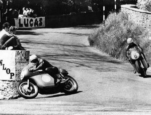 Mike Hailwood leads Rhodesia's Gary Hocking as they go into the last lap in the Junior