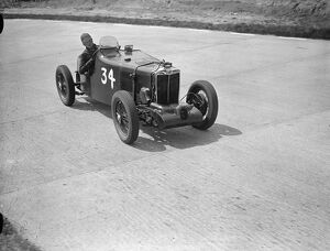 Miss D Stanley-Turner and her supercharged MG on the test hill hairpin during practice