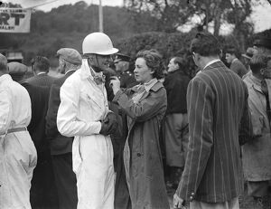 Miss Doreen Evans assists her brother K D Evans who drove an MG with her helmet before