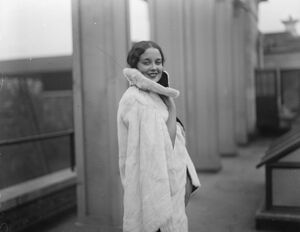 Miss Peggy Lamont, England 's most beautiful girl, in latest ermine cape cloak