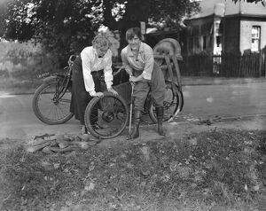 Miss Sybll Arundale and Miss Betty Fairfax out for a motor cycle trip Pumping Up