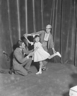 Miss Teddie Gerrard and Mr Harry Pilcer teaching Gwennie Seabrook to dance dance