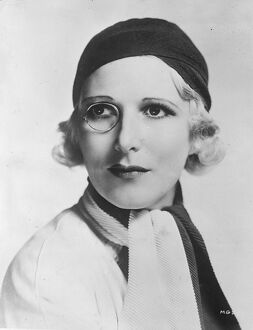 The monocled star. Heather Thatcher, the English actress with her monocle, and a new black