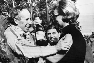 Monza Italy John Surtees is congratulated by Mrs Margherita Bandini widow of Lorenzo Bandini