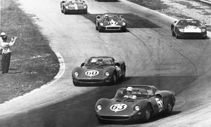 Monza Italy Pictured sweeping round a bend in the 1000 km International Motor Race