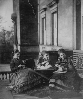 Mother and daughters enjoy their tea outdoors in the afternoon sun