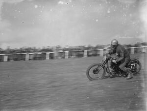 Motor cycling races at Brands Hatch. A scramblers takes the bend. 1936