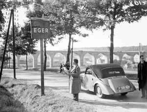 A motorist looking at the sign at the entrance to the town of Eger, the Sudetenland