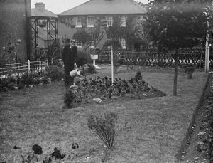Mr F W Sims stands over his prize garden in Horton Kirby. 1938