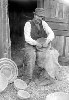 Mr George Lailey engaged in the ancient craft of wooden bowl making at Bucklebury, Berks