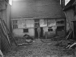Mr Greenfield at an old dilapidated cottage, wich is to be used as a museum in Eynsford