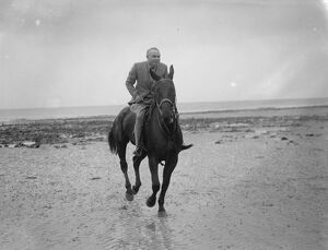 Mr Hore Belisha spends his holiday - on horseback. Away from transport problems