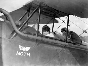 Mrs Alan Cobham leaving Stag Lane Aerodrome to meet her husband in mid air. 13 March