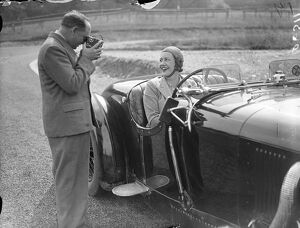 Mrs Roy ( Marjorie ) Eccles being filmed by her husband before racing on the track
