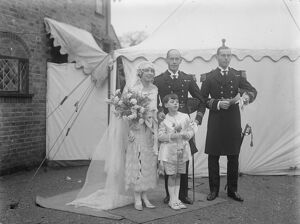 Naval Lieutenant weds Rear Admiral 's daughter. The marriage arranged between Lt