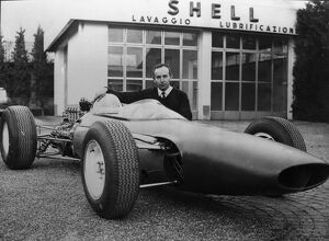 New Ferrari Formula One . Modena , Italy : British race ace John Surtees poses