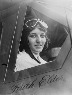 New York to Paris flight. Miss Ruth Elder looking out of cockpit. 1927