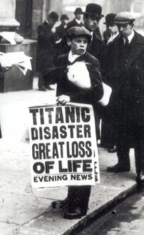 A newspaper boy spreads the news of the sinking of the Titanic to bystanders outside
