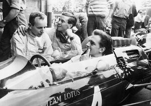 Nurburgring Lotus team driver Trevor Taylor gets some friendly advice from fellow