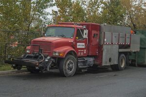 An old International 4 wheeled rigid lorry in use with the fire protection service