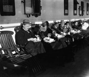 Passengers enjoy some tea on deck aboard the ocean liner, RMS Adriatic of the White