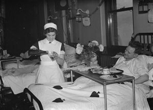Patients receive a Christmas treat , a glass of beer , at the Livingstone Hospital