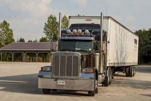 Peterbilt 6x4 semi tracter unit with a twin axle box trailer in the Blue Mountains