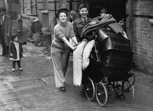 Photo shows: Miss Evyline Nichol and her ATS friend Audrey Towend wheeling a pram